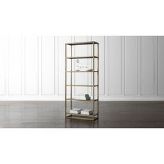 Shop Remi Large Bookcase.  Elegant bookcase rises high in two tones of finished steel to store books and collectibles.  Slender frame is finished in a warm antique brass, inset with handsome black powdercoat shelves.