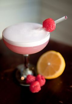 The Clover Club - Dry Gin, Lemon Juice, Raspberry Syrup (Recipe), Superfine Sugar, Egg White, Raspberry.