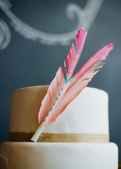 cute idea to adorn cake with handpainted feathers from Pigment and Parchment