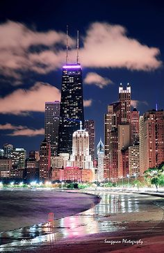 Chicago Lakefront Chicago city urban skyscraper at night at downtown lakefront illuminated with Lake Michigan and water reflection viewed f...
