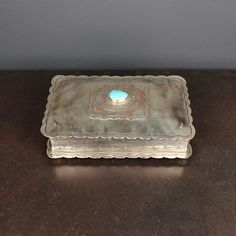 Handmade, hand-stamped german silver rectangular box with oval concho and felt lined interior.