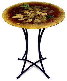 DesignTheSpace has recently launched a website featuring beautifully designed and museum-quality crafted high temperature fused glass, most of which also has hand-painted accents for added intrigue. http://www.jasmineartglass.com/tables/