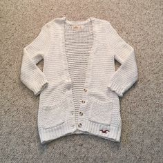 White hollister cardigan! Super cute white cardigan from hollister! Barely worn and lots of life left! Hollister Sweaters Cardigans
