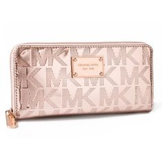 Michael Kors rose gold wallet Michael Kors Signature wallet in rose gold. It is wrapped in rose gold mirrored metallic PVC with Michael Kors block letterin. The front is accented with Michael Kors logo name plate. This zip around style wallet features 8 credit card slots a zippered coin compartment and full length bill compartments. It measures approximately 8 inches (L) x 4 inches (H) x 1 inch (W). MICHAEL Michael Kors Bags Wallets