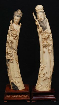 "CHINESE CARVED IVORY EMPEROR AND EMPRESS Pair of large antique Chinese carved ivory emperor and empress carved tusk figures. Each intricately carved to depict them both holding flowers and wearing layered robe. Includes fitted wooden bases. Largest measures approx. 24 1/4"" length (61.5cm). Total weight including bases 6.70 kilograms."