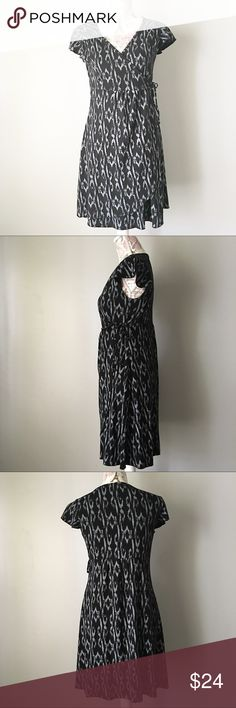 Mary Ellen Black and Gray Wrap Dress Mary Ellen Black and gray Wrap dress. Connected on one side and ties on the other. Beautiful flowy sleeves. Size M Mary Ellen Dresses