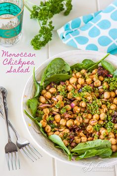 Moroccan Chickpea Salad. A colorful Moroccan salad with nutty chickpeas that are coated in smoky paprika, cinnamon and cumin.