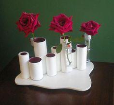 Suportes de mesa com rolinhos de papel higiênico