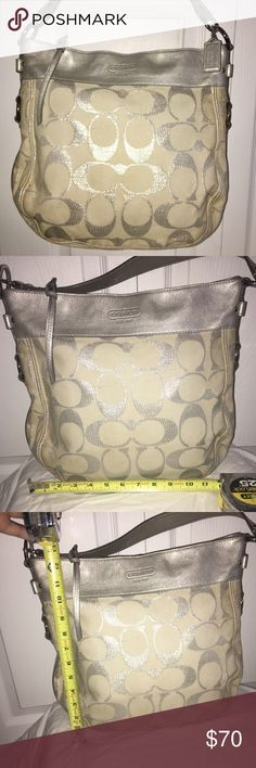 Silver and White Signature Coach Purse White with silver shimmer signature Coach pattern. Bag features single shoulder strap with silver hard wear. Inside is sky blue with pockets for organization. Bag is used and taking that into price consideration. 100% authentic! I can provide more photos for serious inquires. Cross posted on Mercari. Coach Bags Totes