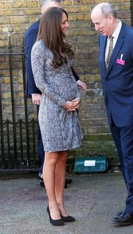 Displaying her baby bump at Hope House in South London