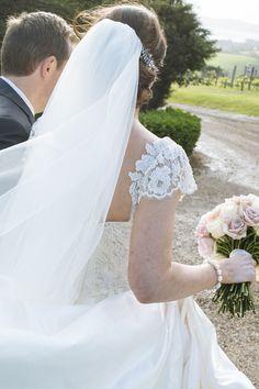 Sleeve detail. Anna Schimmel. Photography: Joanna Wickham - jowickham.co.nz  Read More: http://www.stylemepretty.com/new-zealand-weddings/auckland/2014/01/13/waiheke-island-wedding-at-mudbrick-vineyard/