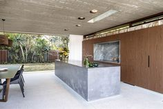 = concrete island + timber |> kitchens Hunters Hill Textural House by Arkhefield