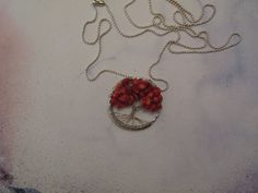 Tree of life. Long necklace made with wire and red corals gemstones. Red coral was believed to prevent ill fortune and offer protection from skin disease when worn as a necklace.