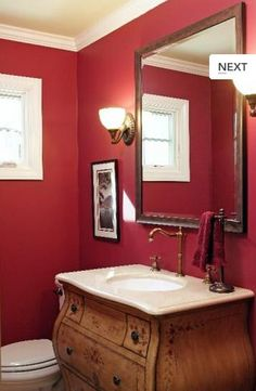 Red bathroom. Upturned lights. Square mirror. Wooden vanity. Pic #28