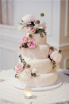 Lovely White, Round, 4 Tiered cake with Pink and White Roses and Peonies