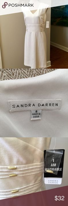 """SANDRA DARREN New! Soft Knit Dress Creamy white dress is soft with stretch for a comfortable fit. Decorative stitching and golden buttons highlight the waist. Subtle cap sleeves. Back zip. Outer fabric is a blend of polyester, rayon and spandex. Full lining of stretchy polyester. Size 8. Armpit to armpit measurement is about 19"""". Waist side to side is about 16"""". Top of shoulder to bottom hem is about 40"""". Extra button included. Washable. New with tag! Sandra Darren Dresses"""