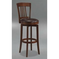 """Hillsdale Canton Swivel 24 1/2"""" High Counter Stool by Hillsdale. $179.00. Color Brown. Style Traditional. Assembled Dimensions 39 in. H x 18 in. D x 18 in. W. Brown Finish. Material Vinyl. The Canton counter stool features a dark walnut finish and a matching dark brown faux leather seat. It boasts a traditional Mission style back design with simple, tapered and slightly flared legs. Includes a 360 degree swivel seat. Enhance your home with this handsome counter bar stool d..."""