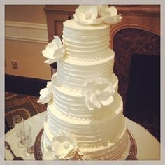 Wedding cakes are so absurdly expensive! This cake probably cost over$500 to make, and isn't really that intricate. It's beautiful and simple, so I will take some cake-making classes, buy the sugar flowers on etsy and save myself a whole lotta money with the same result!