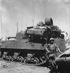 M4-sherman-killer-kwajalein - A captured Type 94 Tankette on the engine deck of a USMC M4 Sherman tank at Kwajalein