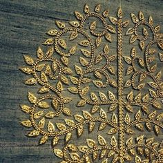 I HAVE NO INFO ABOUT THIS PHOTO. IT IS AN EXAMPLE OF A VERY OLD TECHNIQUE WHICH IMPARTS A 3D EFFECT TO EMBROIDERY. IT MAY BE WRAPPED AND TACKED (COUCHED) CORDING OR BEADS OR SIMPLY HEAVY GOLD EMBROIDERY THREAD. NO MATTER WHAT IT IS A BEAUTIFUL DESIGN AND EXCELLENT TECHNIQUE...