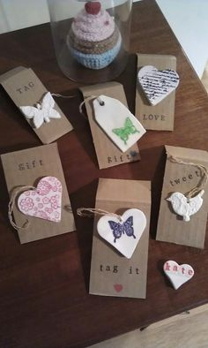 Gift tags made from cornstarch and Bicarb of soda (baking soda in US) from a recipe I found here http://www.mariegracedesigns.com/marie_grace/2008/12/our-favorite-clay-ornaments.html