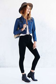 Wear a blue denim jacket with black slim jeans for a Sunday lunch with friends. This outfit is complemented perfectly with black leather chelsea boots.   Shop this look on Lookastic: https://lookastic.com/women/looks/denim-jacket-tank-skinny-jeans/17251   — Blue Denim Jacket  — White Tank  — Black Skinny Jeans  — Black Leather Chelsea Boots  — Brown Wool Hat