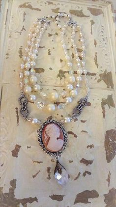Lovely Vintage Pearls, Rosary chain, and Viintage Cameo Assemblage Necklace... This is an assemblage of lovely items handmade and collected vintage, including a beautiful Vintage lady cameo, lovely vintage pearl and ab crystal faceted beaded necklaces from a 1950s necklace,