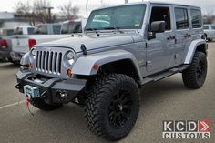 """Jeep Wrangler Unlimited with Mopar 3"""" Fox Racing lift, aftermarket bumpers, XD Misfit wheels, and Toyo tires."""