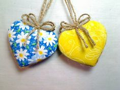 Regular Retail Gift Shop Price: $2.50 for each reversible heart or $5.00 for a set of 2. Now: $4.75 for a set of 2. The set you see in the photos are the ones you will receive. Blue / Yellow - Jute Fabric HEART ornaments .... REVERSIBLE Can utilize either side. Complimentary print on other side of ornament. With a set of 2 you can have 4 different looks as shown in photos. Jute string hanger and bow. Note second picture. Approx. Size: 3 inches not including hanging string. Top a gift,...