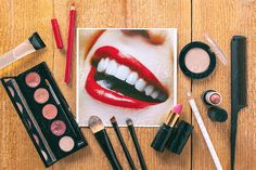 Perfect smile photo on a table with a variety of makeup objects. by BONNINSTUDIO | Stocksy United