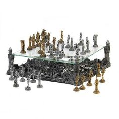 Prepare for battle and defend your kingdom with this intricate and breathtaking medieval-inspired chess set! The glass game board is held aloft by four towers of the castle, revealing the remains of p