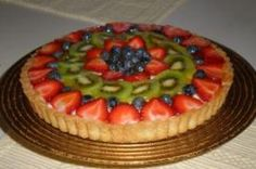 This fresh fruit tart recipe consists of a buttery crisp tart shell filled with a creamy, lemon-flavored custard filling and topped with slices of strawberries and kiwi glazed with apricot preserves. Italian Christmas Desserts, Italian Desserts, Just Desserts, Italian Recipes, Italian Foods, Pastry Recipes, Tart Recipes, Apple Recipes, Cookie Recipes
