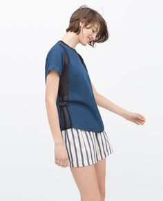 Team these baggy striped shorts with this indigo mesh panel shirt from Zara for a laid back locker room look that's so easy to wear. Indigo shirt £19.99.