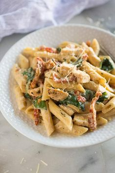 Instant Pot Tuscan Chicken Pasta with a creamy garlic sauce, sun-dried tomatoes, spinach, and chicken. My family quickly fell in love with this yummy, easy pressure cooker meal.