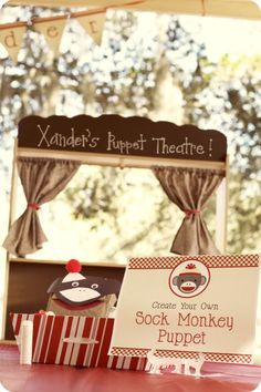 create your own sock monkey station - this one looks like a sign that I've found the right theme... thanks @Mandie Carter! (check out the name on the puppet theatre!)