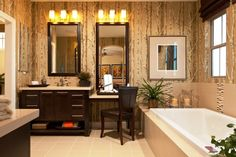 Modern bathroom with shaker cabinets, dark wood cabinets, a drop in tub, beige tile and multicolored walls white tub fixed lamps  of Tips and Tricks for Practical Single Sink Vanity with Makeup Area