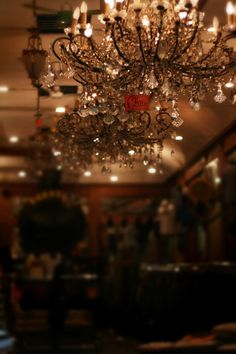 drawing attention to the chandelier without having to drape the rest of the room