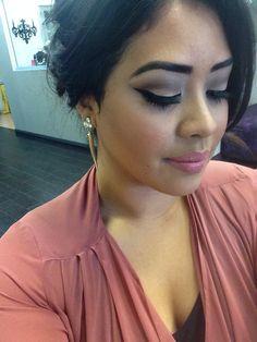 Brown cut crease eyeshadow with winged eyeliner.