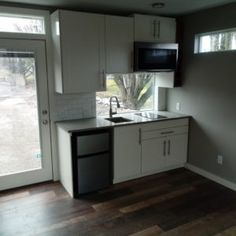Relevant Buildings in Canby Oregon designs and builds beautiful energy efficient homes out of shipping containers. Take a look at our process and call us at to schedule your tour of our container homes. Container Cabin, Energy Efficient Homes, Shipping Container Homes, Cabins, Building A House, Buildings, Kitchen Cabinets, Architecture, City