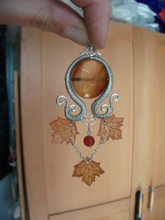 Wire pendant with carneol and handmade plastic leaves