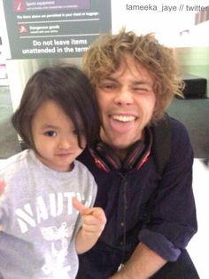Ashton with a young fan