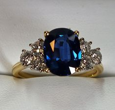 Moissanite engagement ring vintage Art deco Unique engagement ring white gold women Oval Halo Baguette Multi Flower Bridal Anniversary gift Moissanite Size- approx Shape-Oval Side stones: diamonds or CZ are available, Please drop down the Vintage Engagement Rings, Vintage Rings, Saphire Ring, Blue Sapphire Rings, Vintage Sapphire Rings, Vintage Diamond, Jewelry Gifts, Jewelery, Diamonds
