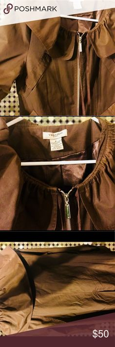 VERTIGO PARIS SZ M Women's Trench A gorgeous shiny brown ladies trench with ruffled color. 52% Polyester 48% Cotton. Lining 100% Polyester.   **Flap at the bottom of the jacket (which serves no purpose whatsoever in my opinion) is missing the button. But it is not noticible as the flap covers where the button is supposed to be. Does not effect the looks or wearability of the jacket in any way  This is a new jacket without tags. Vertigo Paris Jackets & Coats Trench Coats