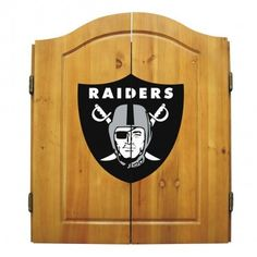 Oakland Raiders Dart Cabinet Set NFL Dartboards Adding our Oakland Raiders NFL Logo Dart Cabinet Set to your home or business is a great way to show you're a true fan! The NFL Team Logo is printed on the front of the doors and on the interior Nfl Oakland Raiders, Pittsburgh Steelers, Dallas Cowboys, Raiders Football, Indianapolis Colts, Cincinnati Reds, Raiders Team, Houston Texans