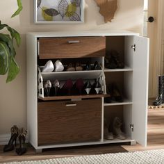 This contemporary-styled storage cabinet will help you tap into your home's underutilized vertical storage space. This walnut and white fold-out rack provides convenient access to shoes and riding spurs.