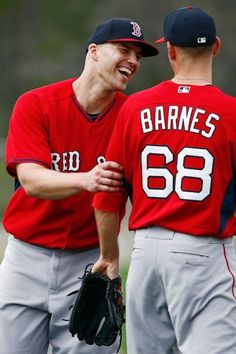 Boston Red Sox starting pitcher Justin Masterson, left, laughs with starting pitcher Matt Barnes (68) during a baseball spring training in Fort Myers, Fla., Wednesday, Feb. 25, 2015. (AP Photo/Naples Daily News, Corey Perrine) Boston Red Sox Team Photos - ESPN