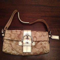 Coach Shoulder Bag Gently used Gold, tans, and brown Coach Shoulder bag. Has two compartments, larger main compartment also contains zippered pocket, and cellphone like pocket. Coach Bags Shoulder Bags