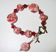 Breast Cancer Awareness Bracelet Small Size 6 in Pink Lampwork Glass and Raspberry Crystals by #judesjujus, $65.00 #jetteam #jewelryonesty
