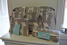 Check out this item in my Etsy shop https://www.etsy.com/listing/163862791/grey-giraffe-nappy-bag-nappy-mat-nappy