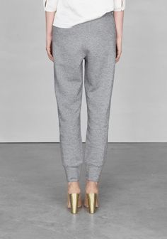 the comfy pants and showy heels are a marvelous, inspiring combination resplendent with personality and ease—trousers and styling by & other stories
